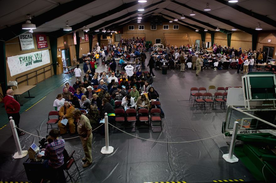 A gym is turned into a waiting room for patients waiting to see doctors at the Remote Area Medical facilities at Southern Virginia University early this month. (Andrew Harnik/The Washington Times)