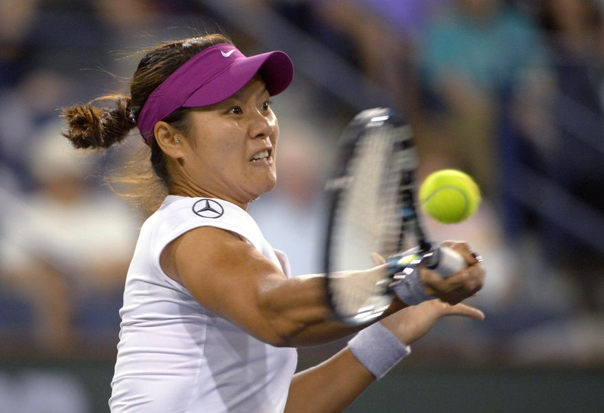 Li Na, of China, returns a shot to Aleksandra Wozniak, of Canada, at the BNP Paribas Open tennis tournament, Tuesday, March 11, 2014, in Indian Wells, Calif. (AP Photo/Mark J. Terrill)