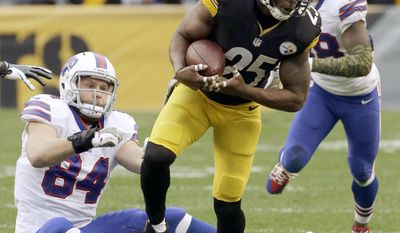 Pittsburgh Steelers' Ryan Clark (25) intercepts a pass as Buffalo Bills' Scott Chandler (84) looks on during the second half of an NFL football game on Sunday, Nov. 10, 2013, in Pittsburgh. (AP Photo/Gene J. Puskar)