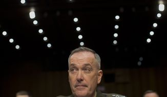 "Marine Gen. Joseph F. Dunford, Jr., Commander, International Security Assistance Force, listens on Capitol Hill in Washington, Wednesday, March 12, 2014, while testifying before the Senate Armed Services Committee on the situation in Afghanistan. President Barack Obama has threatened to withdraw all American forces from Afghanistan if a new security agreement is not signed by the end of the year, but there is no legal reason the U.S. has to resort to the ""zero option,"" as administration officials have repeatedly claimed.  (AP Photo/Carolyn Kaster)"
