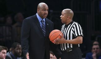 Georgetown head coach John Thompson III, left, argues with the referee during the first half of an NCAA men's college basketball game against DePaul in the first round of the Big East tournament at Madison Square Garden, Wednesday, March 12, 2014, in New York. (AP Photo/John Minchillo)