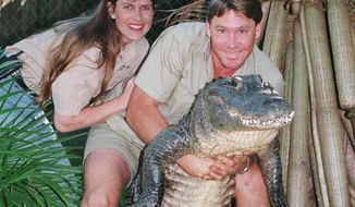 "FILE - In this June 18, 1999 file photo, Steve Irwin, ""The Crocodile Hunter"" holds a nine-foot female alligator accompanied by his American wife Terri, who is from Eugene, Oregon, at his ""Australia Zoo"" in Beerwah, Queensland, Australia. Australia's famed ""Crocodile Hunter"" Steve Irwin knew he was dying after a massive stingray stabbed him in the chest hundreds of times, the only witness to the fatal 2006 attack said in his first detailed public account of the beloved conservationist's death. (AP Photo/Russell McPhedran, File)"
