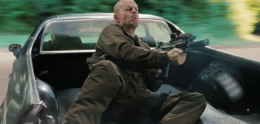 Bruce Willis fires an FN SCAR rifle in G.I. Joe.