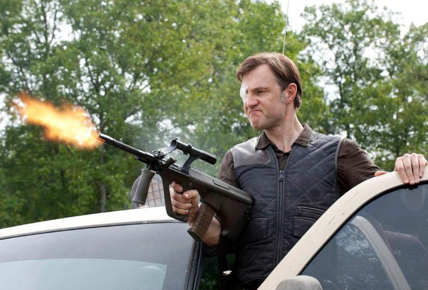 The Governor (David Morrissey) trims the zombie population with a Steyr Aug in the TV series Walking Dead.