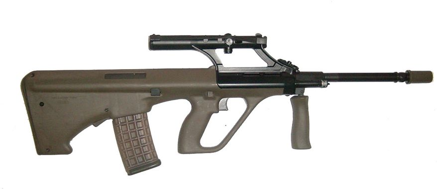 The AUG, a bullpup 5.56mm automatic rifle, is a selective fire weapon with a conventional gas piston operated action that fires from a closed bolt.[5] Designed as a family of rifles that could be quickly adapted to a wide variety of roles with the change of the barrel to a desired length and profile, the AUG is a modular configuration rifle that employs a high level of polymer and advanced alloy components.