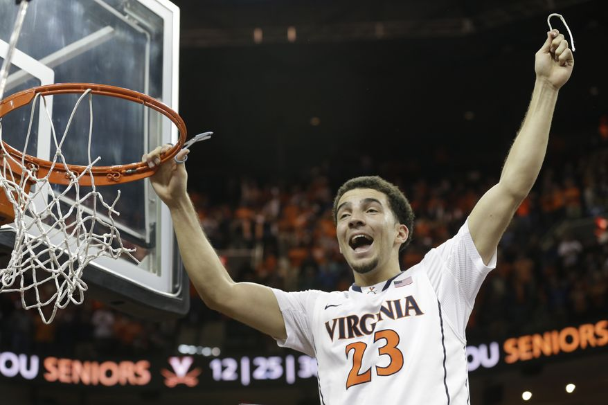 Virginia guard London Perrantes (23) celebrates his teams win over Syracuse after an NCAA College basketball game in Charlottesville, Va., Saturday, March 1, 2014. Virginia won the game 75-56. (AP Photo/Steve Helber)