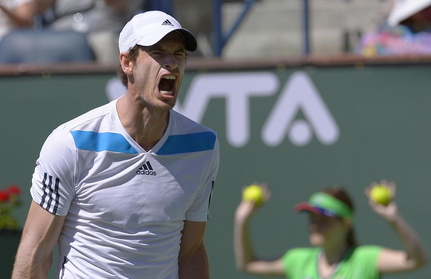 Andy Murray, of Great Britain, reacts after losing a point against Milos Raonic, of Canada, during  fourth round match at the BNP Paribas Open tennis tournament, Wednesday, March 12, 2014, in Indian Wells, Calif. (AP Photo/Mark J. Terrill)
