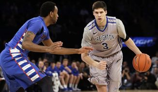 DePaul's Forrest Robinson, left, defends against Creighton's Doug McDermott (3) during the first half of an NCAA college basketball game in the quarterfinals of the Big East Conference tournament on Thursday, March 13, 2014, at Madison Square Garden in New York. (AP Photo/Frank Franklin II)