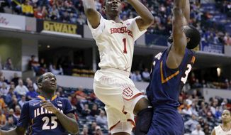 Indiana forward Noah Vonleh goes up for a shot against Illinois center Nnanna Egwu (32) during the first half of an NCAA college basketball game in the first round of the Big Ten Conference tournament Thursday, March 13, 2014, in Indianapolis. (AP Photo/Michael Conroy)