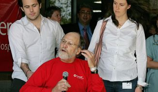 FILE - In this April 30, 2007, file photo, son Jeffrey Corzine, left, and daughter Jennifer Corzine-Pisani, listen as New Jersey Gov. Jon S. Corzine addresses the media outside Cooper University Hospital in Camden, N.J., as he was released after being hospitalized for serious injuries in an automobile accident on April 12. A spokesman for the former governor announced on Thursday, March 13, 2014, that Jeffrey Corzine had died at age 31. There were no other details available. (AP Photo/Mel Evans, File)