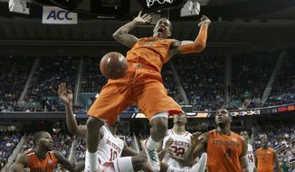 Miami's Rion Brown (15) dunks against North Carolina State during the first half of a second round NCAA college basketball game at the Atlantic Coast Conference tournament in Greensboro, N.C., Thursday, March 13, 2014. (AP Photo/Gerry Broome)