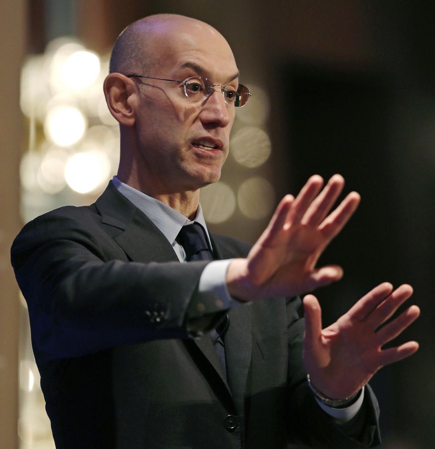 "NBA commissioner Adam Silver gestures during an address, Wednesday, March 12, 2014, in Boston. Silver commented on some teams with losing records ""tanking"" towards the end of a season as an effort to rebuild through the NBA draft. (AP Photo/Charles Krupa)"