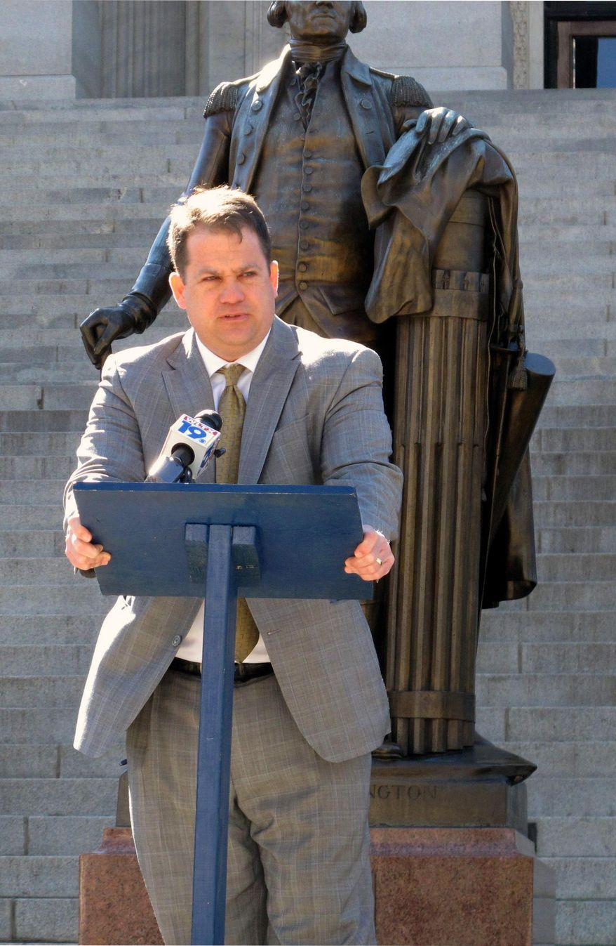 Republican U.S. Senate candidate Lee Bright speaks after signing an agreement to support any challenger who gets into a runoff with U.S. Sen. Lindsey Graham in June, on the steps of the Statehouse, Thursday, March 13, 2014, in Columbia, S.C. Six GOP candidates have said they want to take on Graham as he seeks a third term. (AP Photo/Jeffrey Collins)