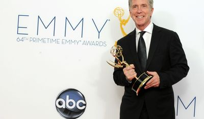 "FILE - In this Sept. 23, 2012 file photo, TV personality Tom Bergeron, winner Outstanding Host For A Reality-Competition Program, poses backstage at the 64th Primetime Emmy Awards at the Nokia Theatre in Los Angeles. Bergeron is leaving ""America's Funniest Home Videos"" at the end of next season, but William Shatner is not quitting Twitter. The two became linked when Bergeron announced on Tuesday, March 11, 2014, that he would step down as host of the show next year. (Photo by Jordan Strauss/Invision/AP, file)"