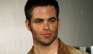 """FILE - In this Dec. 4, 2012 file photo, actor Chris Pine attends a press conference for his latest film """"Star Trek Into Darkness"""" in Tokyo. Pine, known for playing Captain Kirk in the """"Star Trek"""" movies, has been charged with drunken driving in New Zealand. Court officials said Wednesday, March 12, 2014, that the 33-year-old American is due to make his first court appearance in the case on Monday, March 17. (AP Photo/Koji Sasahara, File)"""