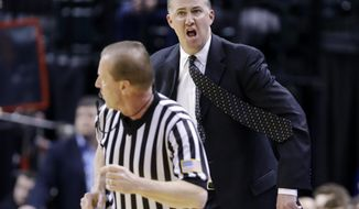 Purdue head coach Matt Painter argues a call with an official during the first half of an NCAA college basketball game against Ohio State in the first round of the Big Ten Conference tournament Thursday, March 13, 2014, in Indianapolis. (AP Photo/Michael Conroy)