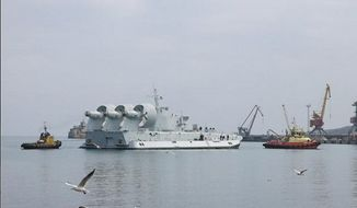 Two tugs are seen towing the second Ukraine built Zubr class air-cushioned landing craft for China. (phistory.info)