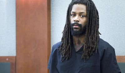 Kirk Bills appears in court at the Regional Justice Center in Las Vegas Wednesday, March 12, 2014. Bills and pet shop owner Gloria Lee pleaded not guilty to charges of torching the pet shop where 27 puppies were rescued, and a judge rejected a bid for lower bail. (AP Photo/Las Vegas Sun/Steve Marcus)