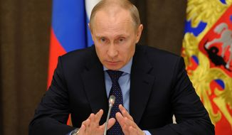 Russian President Vladimir Putin chairs a meeting on economic issues in the Bocharov Ruchei residence in Sochi, Russia, Wednesday, March 12, 2014. (AP Photo/RIA-Novosti, Mikhail Klimentyev, Presidential Press Service)