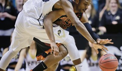 Colorado's John Hopkins (23) reaches to strip Southern California's Byron Wesley of the ball in the first half of an NCAA college basketball game in the Pac-12 men's tournament, Wednesday, March 12, 2014, in Las Vegas. (AP Photo/Julie Jacobson)