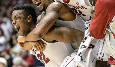 10ThingstoSeeSports - Players on the Alabama bench, including guards Retin Obasohan (32), Trevor Releford and Rodney Cooper (21) celebrate a basket by walk-on guard Isiah Wilson during an NCAA college basketball game against Arkansas on Saturday, March 8, 2014, in Tuscaloosa, Ala. (AP Photo/AL.com, Vasha Hunt, File)