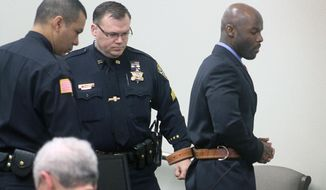 Arthur Morgan III enters a court room in Freehold, N.J. on the first day of his trial for the murder of his daughter Tierra Morgan-Glover, Wednesday, March 12, 2014. (AP Photo/Asbury Park Press, Tom Spader, Pool)