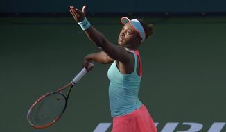 Sloane Stephens, of the United States, serves to Flavia Pennetta, of Italy, during a quarterfinal at the BNP Paribas Open tennis tournament, Thursday, March 13, 2014 in Indian Wells, Calif. (AP Photo/Mark J. Terrill)