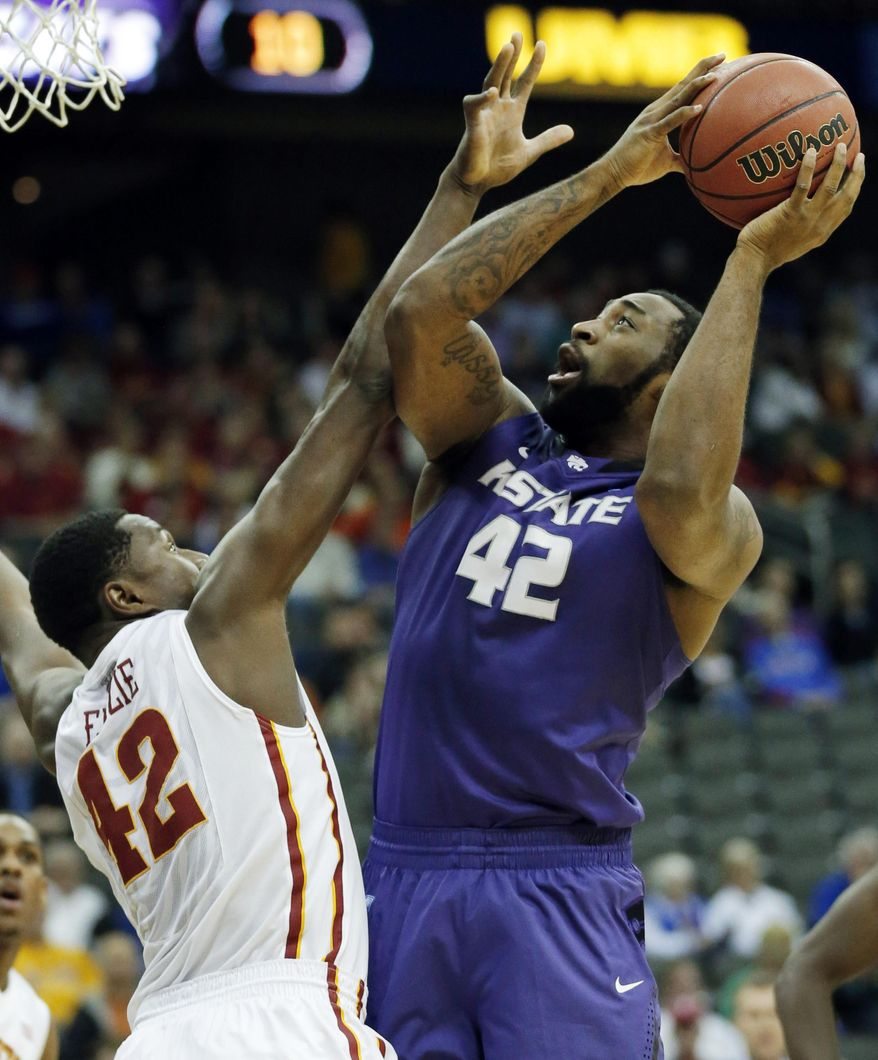 Kansas State forward Thomas Gipson, right, is fouled by Iowa State forward Daniel Edozie, left, during the first half of an NCAA college basketball game in the quarterfinals of the Big 12 Conference men's tournament in Kansas City, Mo., Thursday, March 13, 2014. (AP Photo/Orlin Wagner)