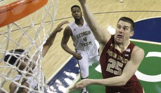 Boston College's Joe Rahon (25) drives past Georgia Tech's Robert Carter, Jr. (4) during the first half of a first round NCAA college basketball game at the Atlantic Coast Conference tournament in Greensboro, N.C., Wednesday, March 12, 2014. (AP Photo/Bob Leverone)