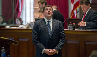 Rep. Timothy Hill, R-Blountville, looks toward the House gallery where Common Core opponents were gathered during a floor debate in Nashville, Tenn., Thursday, March 13, 2014. Hill's bill was amended to include a delay in Common Core standards before it was passed by the chamber. (AP Photo/Erik Schelzig)