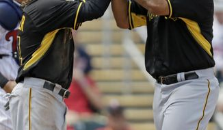 Pittsburgh Pirates third baseman Pedro Alvarez, right, is greeted by Jaff Decker after the two scored on Alvarez' two-run homer in the third inning of an exhibition baseball game in Fort Myers, Fla., Wednesday, March 12, 2014. (AP Photo/Gerald Herbert)
