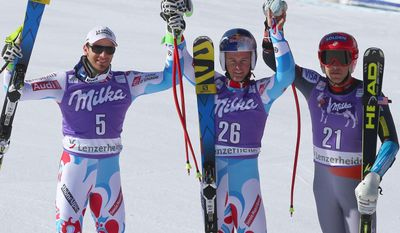 France's Alexis Pinturault, center, the winner, celebrates with teammate and runnerup Thomas Mermillod Blondin, left, and third placed Bode Miller, of the United States, in the finish area after a men's alpine skiing Super-G at the World Cup finals in Lenzerheide, Switzerland, Thursday, March 13, 2013. (AP Photo/Marco Trovati)