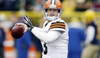 FILE - In this Oct. 20, 2013, file photo, Cleveland Browns' Brandon Weeden warms up before an NFL football game against the Green Bay Packers in Green Bay, Wis. Browns have released quarterback Weeden. (AP Photo/Tom Lynn, File)