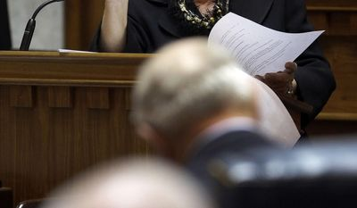 Sen. Karen Tallian, D-Portage, urges defeat of a conference committee report on SB1, a corporate tax rate cutting bill, on the final day of the 2014 legislative session at the Statehouse in Indianapolis, Thursday, March 13, 2014.  (AP Photo/AJ Mast)
