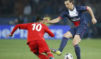 PSG's Zlatan Ibrahimovic, right, vies for the ball with Leverkusen's Emre Can during a Champions League last 16 second leg soccer match between Paris Saint Germain and Bayer Leverkusen at Parc des Princes stadium in Paris, Wednesday, March 12, 2014. (AP Photo/Michel Euler)