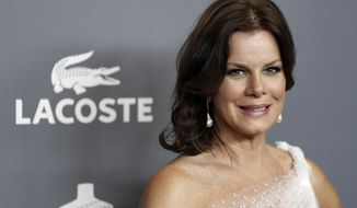 "FILE - In this Feb. 21, 2012 file photo, actress Marcia Gay Harden arrives at the 14th Annual Costume Designers Guild Awards at the The Beverly Hilton hotel in Beverly Hills, Calif. Since getting cast in the film adaptation of ""Fifty Shades of Grey,"" Jamie Dornan, who plays the S&M loving, billionaire Christian Grey, has largely stayed out of the public eye. This aura of mystery surrounding Dornan is a good thing, according to Gay Harden, who plays his mother in the movie. (AP Photo/Matt Sayles, file)"