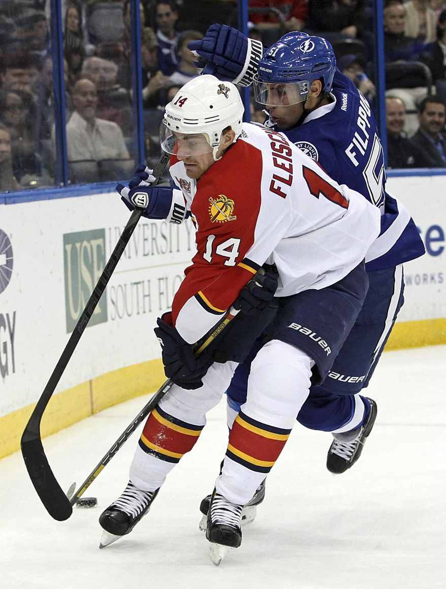 Florida Panthers left wing Tomas Fleischmann (14) vies for the puck against Tampa Bay Lightning center Valtteri Filppula, of Finland, during the first period of an NHL hockey game Thursday, March 13, 2014, in Tampa, Fla. (AP Photo/Brian Blanco)