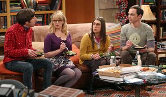 """This image released by CBS shows, from left, Simon Helberg, Melissa Rauch, Mayim Bialik and Jim Parsons in a scene from """"The Big Bang Theory."""" CBS says it's renewing its hit comedy """"The Big Bang Theory"""" for three more years. This extraordinary deal would carry TV's most-watched sitcom through the 2016-2017 season, the series' tenth on the air. """"The Big Bang Theory"""" premiered in September 2007, and has been a ratings smash for virtually its entire run. This season it has averaged nearly 20 million viewers each week. (AP Photo/CBS, Michael Yarish)"""