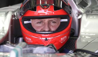 FILE - In this Nov. 23, 2012 file photo, Grand Prix driver Michael Schumacher, of Germany, sits in his car during a free practice at the Interlagos race track in Sao Paulo, Brazil. Michael Schumacher's agent said Wednesday March 12, 2014, that there are small signs that the Formula One champion will wake from the coma he has been in for more than two months. Still, Wednesday's statement from Sabine Kehm tempered optimism with caution. (AP Photo/Victor Caivano, File)