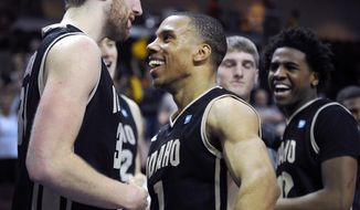 Idaho's Stephen Madison, left and Glen Dean celebrate after defeating UMKC, 73-70, in an NCAA college basketball game during in the first round of the West Athletic Conference men's tournament Thursday, March 13, 2014, in Las Vegas. (AP Photo/David Becker)