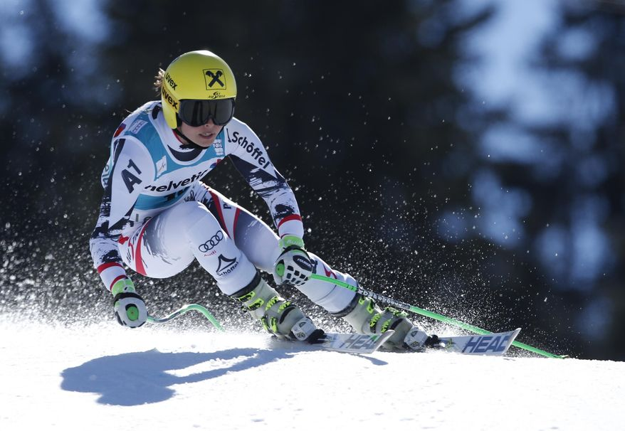 Austria's Anna Fenninger competes on her way to finish in second place, during a women's alpine skiing Super-G at the World Cup finals in Lenzerheide, Switzerland, Thursday, March 13, 2014. (AP Photo/Marco Trovati)