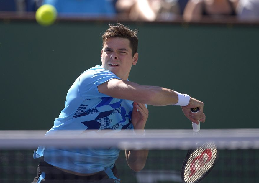 Milos Raonic, of Canada, returns a shot against Andy Murray, of Great Britain, during a fourth round match at the BNP Paribas Open tennis tournament, Wednesday, March 12, 2014, in Indian Wells, Calif. (AP Photo/Mark J. Terrill)