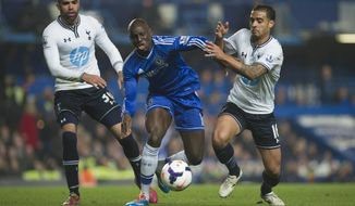 Chelsea's Demba Ba, center, fights for the ball with Tottenham Hotspur's Kyle Naughton and Sandro, left, during their English Premier League soccer match, at the Stamford Bridge Stadium in London, Saturday March 8, 2014. (AP Photo/Bogdan Maran)