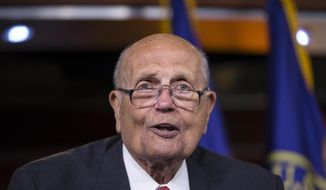 FILE - In this Oct. 4, 2013 file photo, Rep. John Dingell, D-Mich. speaks on Capitol Hill in Washington. Outgoing Rep. Dingell will have surgery in Detroit to correct an abnormal heart rhythm. A statement released by Dingell's office says the 87-year-old Dearborn Democrat will undergo a minimally invasive procedure Thursday at Henry Ford Hospital.  (AP Photo/J. Scott Applewhite, File)