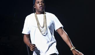 FILE - In this Oct. 10, 2013 file photo, U.S singer Jay Z performs on stage at the o2 arena in east London, as part of his Magna Carta World Tour. Jay Z and Kanye West joined forces Wednesday night, March 12, 2014, during SXSW in Austin, Texas. (Photo by Joel Ryan/Invision/AP, File)