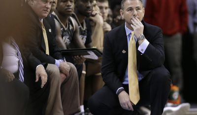 Central Florida coach Donnie Jones, right, watches during the first half of an NCAA college basketball game against Temple at the American Athletic Conference men's tournament Wednesday, March 12, 2014, in Memphis, Tenn. (AP Photo/Mark Humphrey)