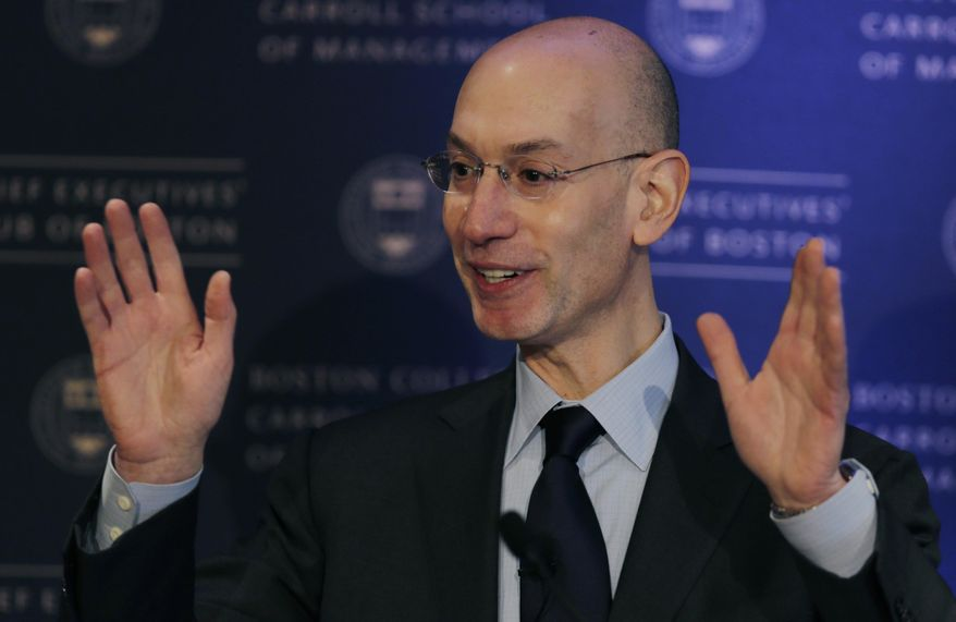 """NBA commissioner Adam Silver gestures during an address, Wednesday, March 12, 2014, in Boston. Silver commented on some teams with losing records """"tanking"""" towards the end of a season as an effort to rebuild through the NBA draft. (AP Photo/Charles Krupa)"""