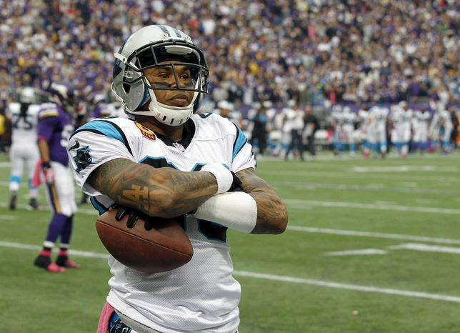 """FILE - In this Oct. 13, 2013 file photo, Carolina Panthers wide receiver Steve Smith crosses his arms after a touchdown catch against the Minnesota Vikings during the first half of an NFL football game in Minneapolis. The agent for  Smith says the five-time Pro Bowl selection has played his final snap for the Panthers. Smith's longtime representative Derrick Fox told The Associated Press on Wednesday, March 12, 2014,  that Smith """"is not going to play for the Panthers next year, I know that. I just don't know when that transaction is going to take place."""" (AP Photo/Ann Heisenfelt, File)"""