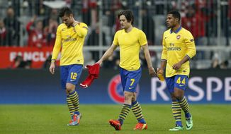 Arsenal's Oliver Giroud, Tomas Rosicky and Serge Gnabry, from left, leave the pitch after the Champions League round of 16 second leg soccer match between FC Bayern Munich and FC Arsenal in Munich, Germany, Wednesday, March 12, 2014. (AP Photo/Matthias Schrader)