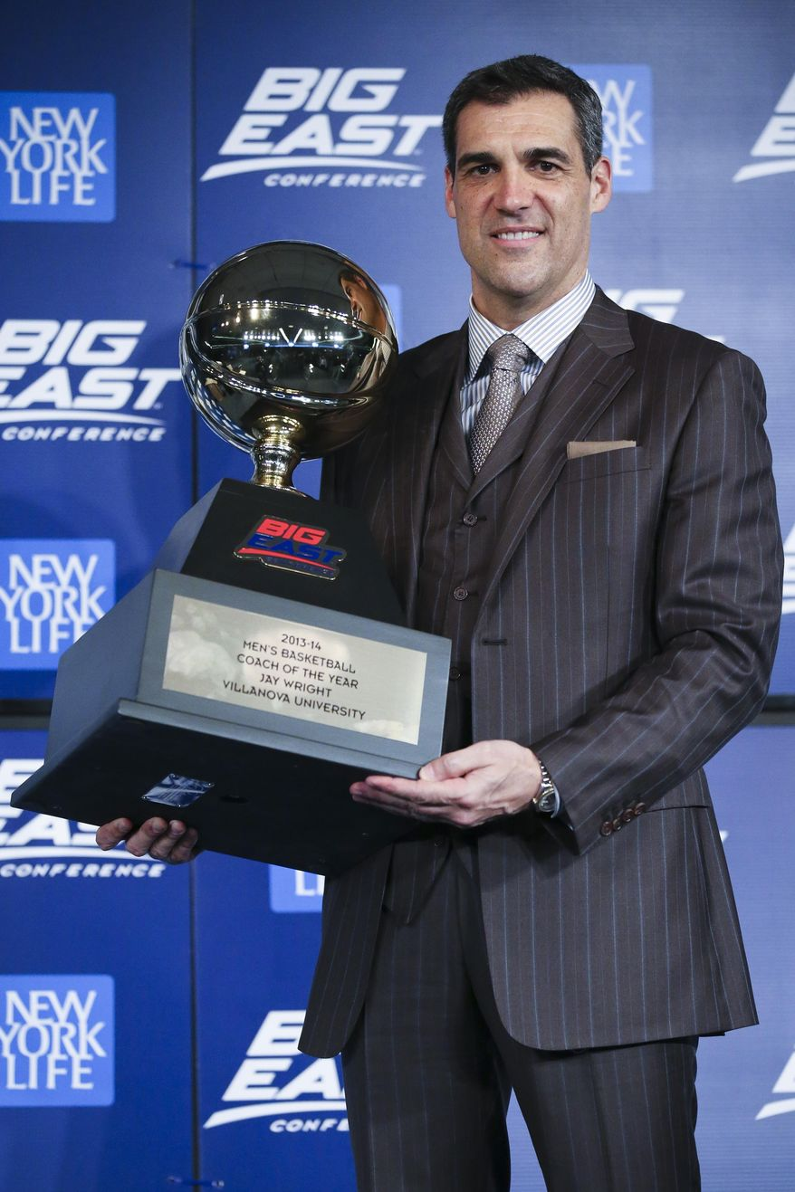 Villanova head coach Jay Wright holds his Big East Conference Coach of the Year trophy during a media availability before the Big East NCAA college basketball tournament on Wednesday, March 12, 2014, in New York. (AP Photo/John Minchillo)